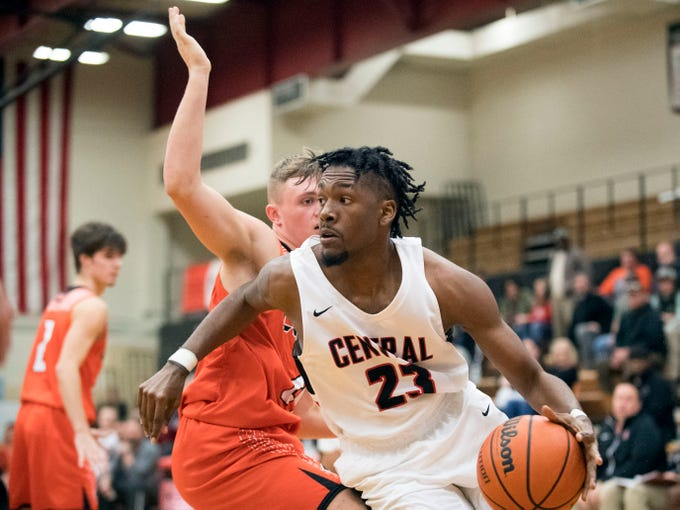 Central's Sean Oglesby (23) gets by Clinton's Trevor Bryant (21) on Tuesday, December 11, 2018.