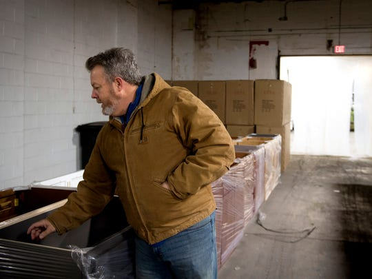 Joel Piper, vice president of Knox Rail Salvage, points out cabinet pieces on Dec. 12 in the warehouse part of Knox Rail Salvage's new location at 4214 Greenway Drive in Knoxville.