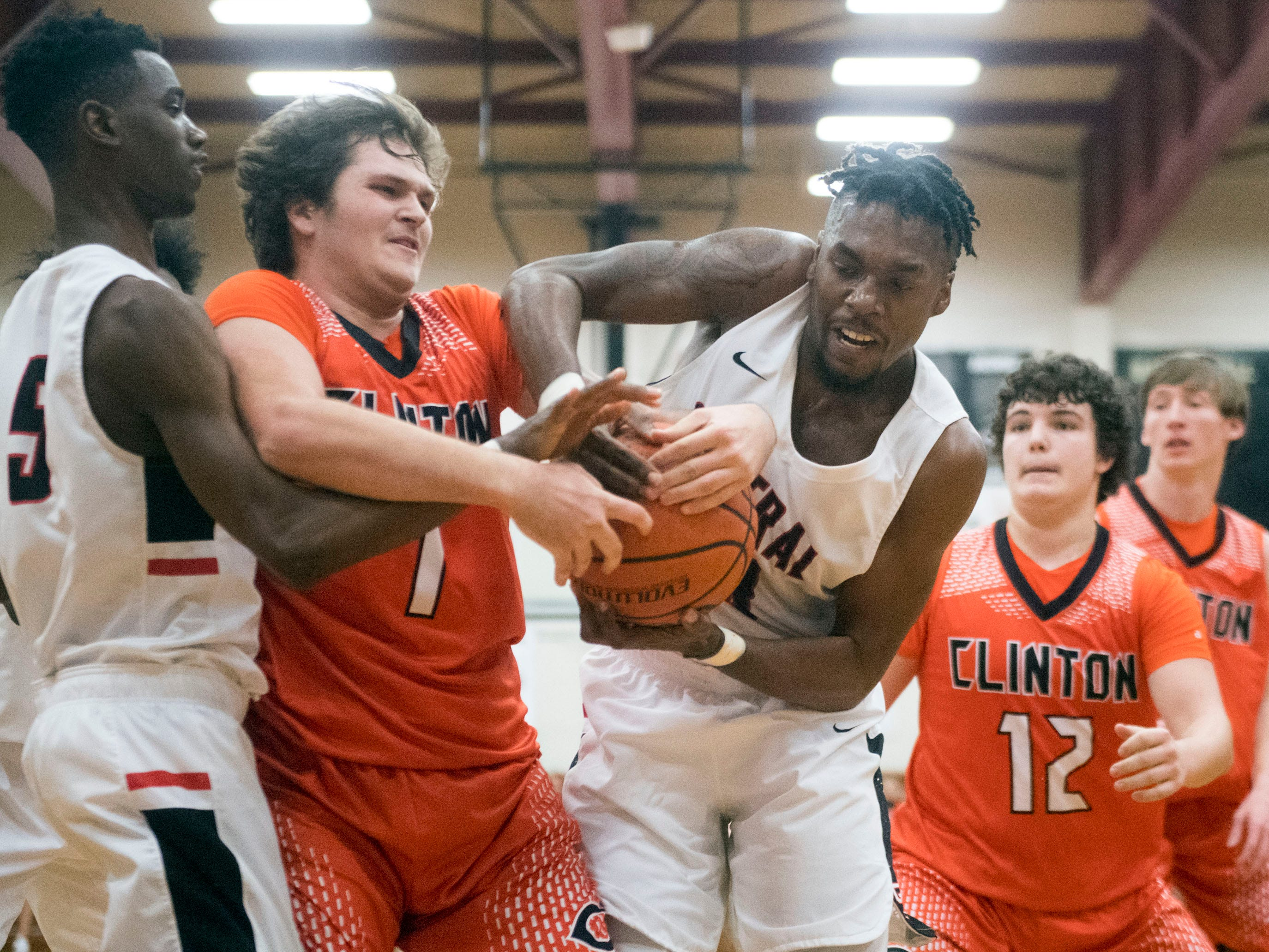 Clinton's Andrew Shoopman (1) loses the ball between Central's Irakoze Frank (5) and Sean Oglesby (23) on Tuesday, December 11, 2018.