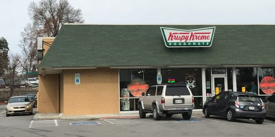 Krispy Kreme on Kingston Pike, near the Northshore Drive intersection, had long lines on Wednesday. Customers can get a dozen Original Glazed doughnuts for $1 with the purchase of any dozen doughnuts on Wednesday, Dec. 12.