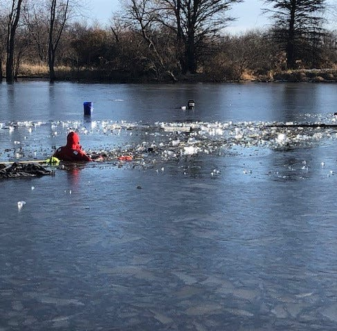 Fisherman rescued from icy pond after 20 minutes underwater