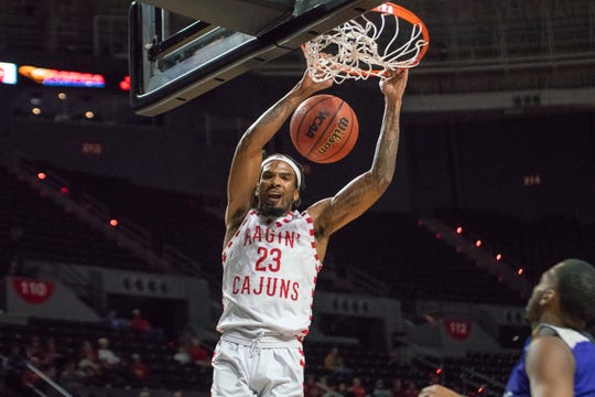 UL's JaKeenan Gant throws down two of his 27 points during the Cajuns' 122-90 win over Prairie View A&M on Tuesday in the Cajundome.