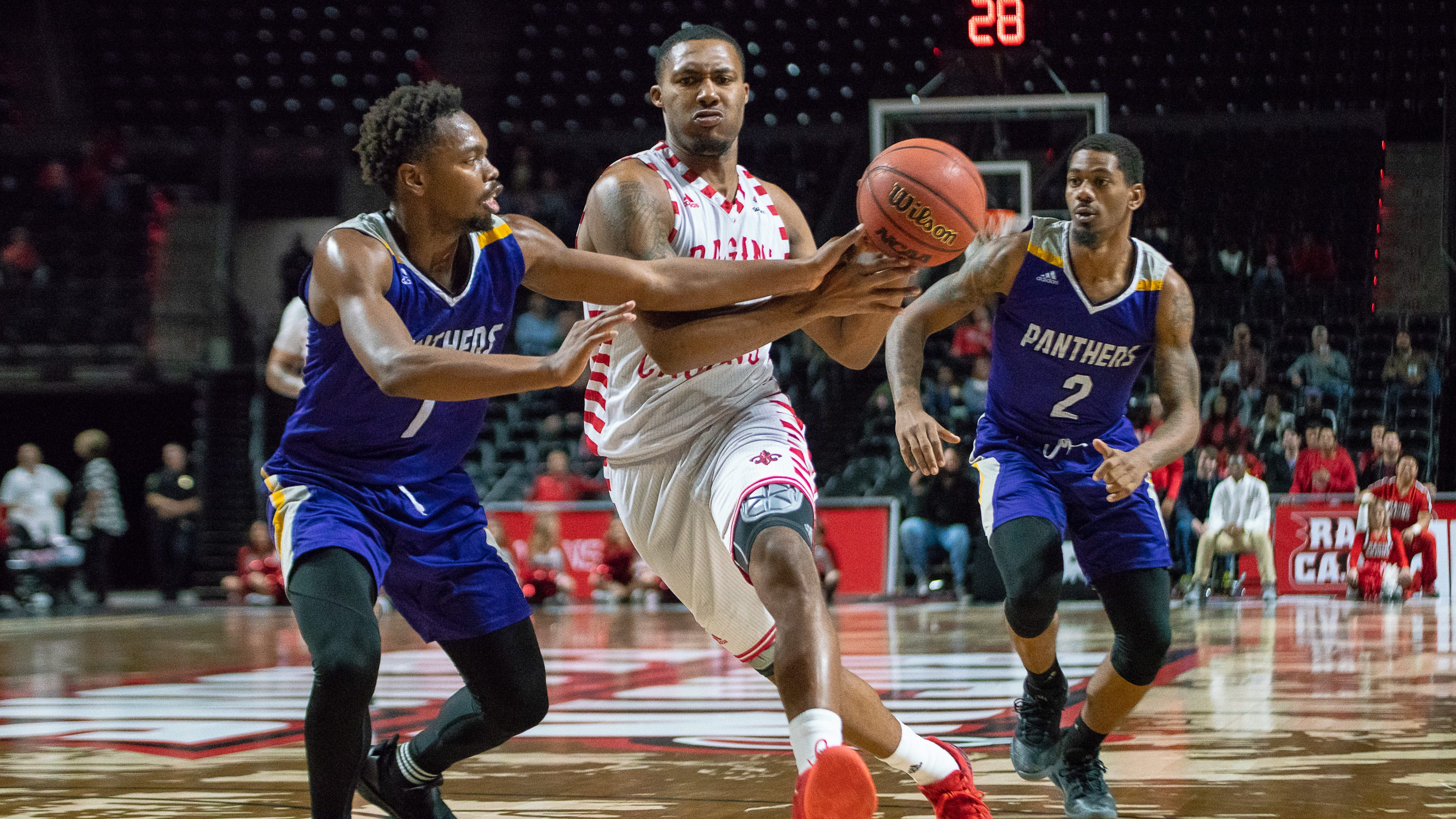 UL's Jerekius Davis makes a drive to the goal as the Ragin' Cajuns take on the Prairie View A&M Panthers at the Cajundome on December 11, 2018.