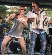 Grammy winner Chubby Carrier, right, jams with Judith Seid on rubboard at the 2018 Festivals Acadiens et Creoles in Girard Park.