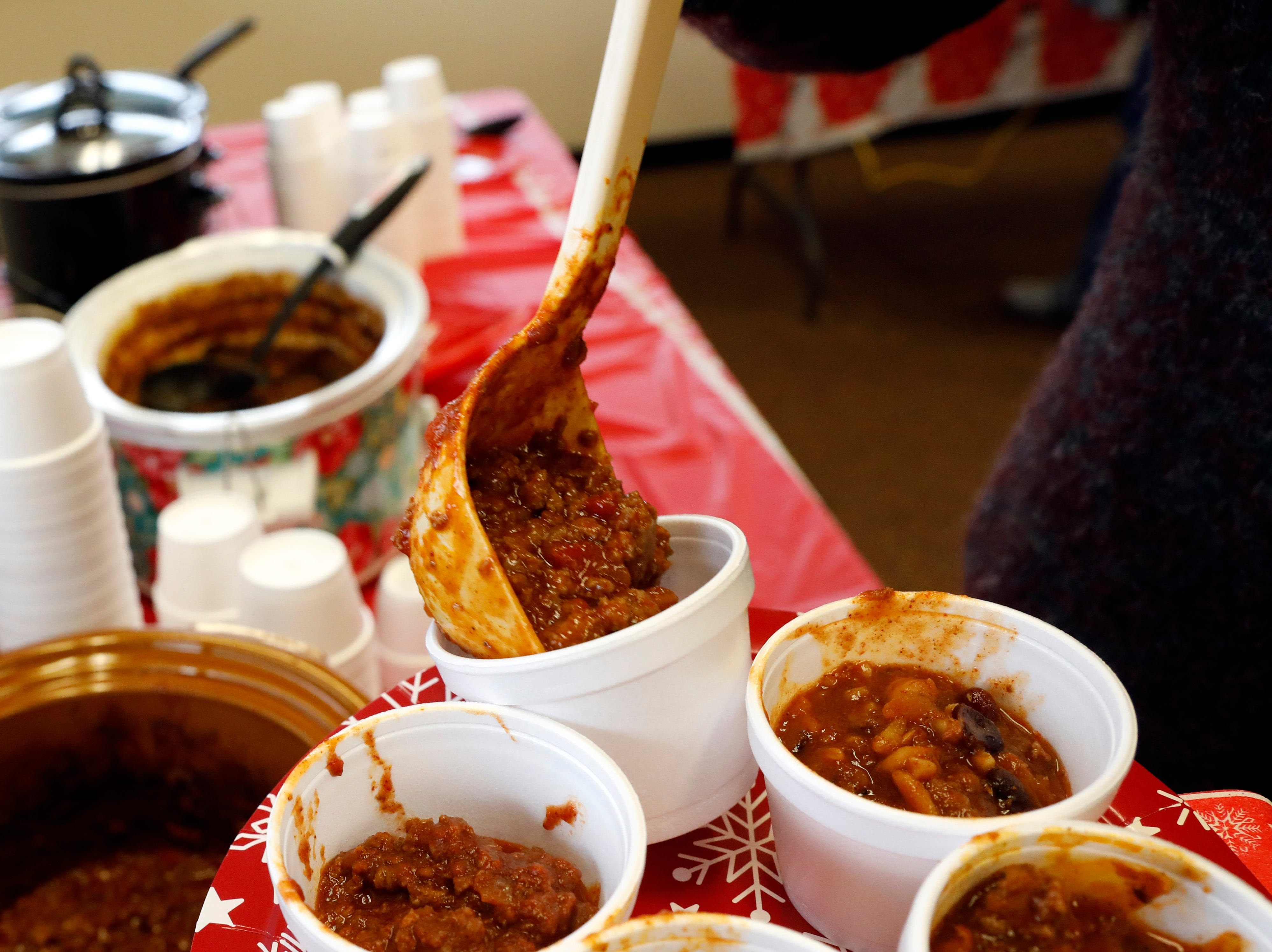 Lancaster Assistant Law Director Stephanie Hall ladles chili into a cup on her plate Tuesday, Dec. 12, 2018, at the Fairfield-Hocking-Athens Major Crimes Unit's annual chili cook-off in Lancaster.