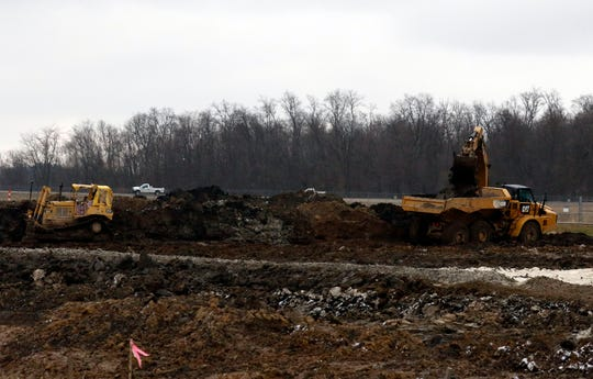 Construction crews work at the site of the General Sherman Junior High School Wednesday afternoon, Dec. 6, 2018, on Election House Road in Lancaster.