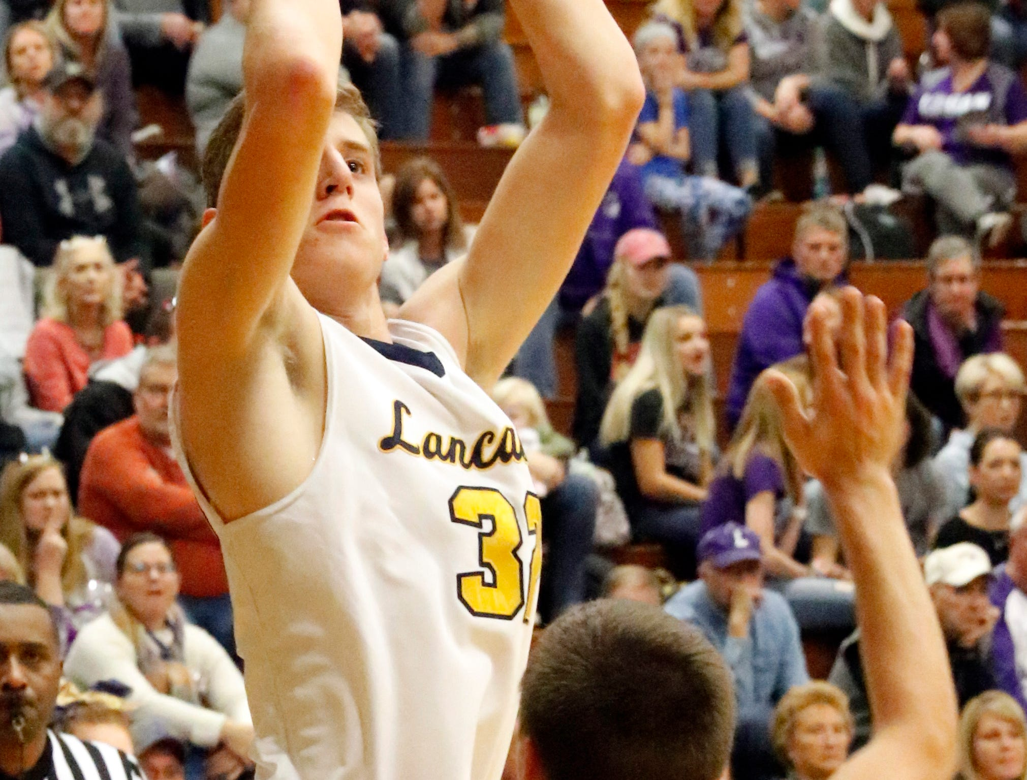 Lancaster's Tanner Roush takes a shot Tuesday night, Dec. 11, 2018, against Logan at Lancaster High School in Lancaster. The Golden Gales lost the game 65-37.