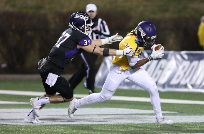 Brighton graduate Nick Brish of Mount Union sacks Mary Hardin-Baylor quarterback Carl Robinson III for a safety during  the 2017 NCAA Division III championship game.