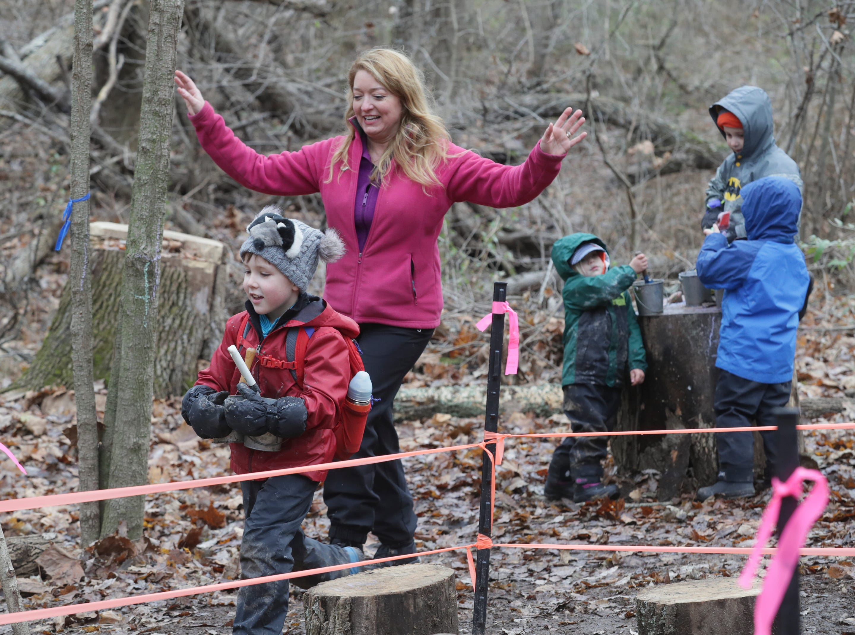 Tavia Cathcart Brown, Executive Director of Creasey Mahan Nature Preserve, works with the students at Thrive Forest School.November 19, 2019