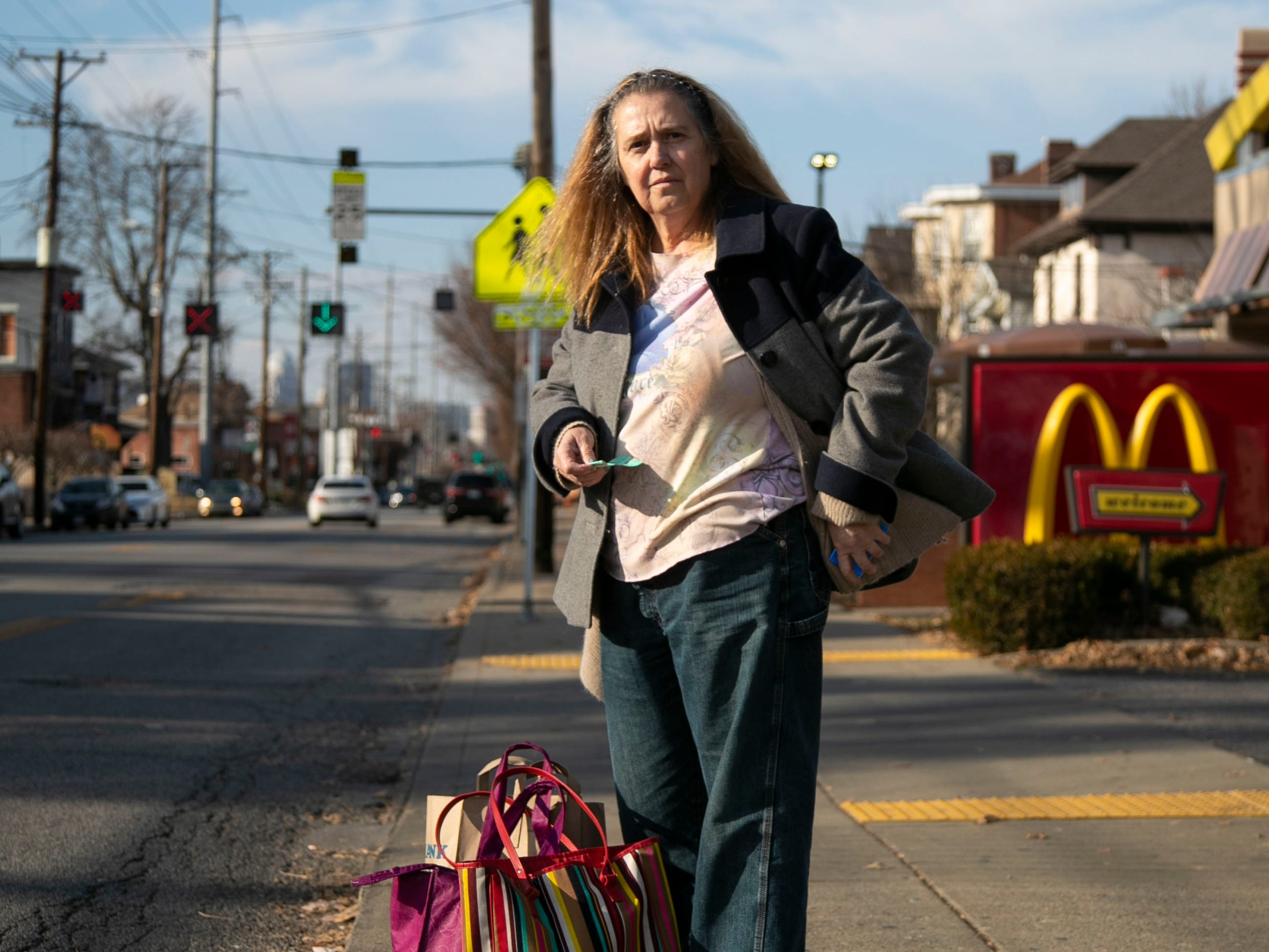 Michele Dutcher takes a bus to and from the Valumarket at the Mid City Mall on Bardstown Road a few times a week for groceries. She can't carry a lot so frequent trips are necessary from her Old Louisville apartment.