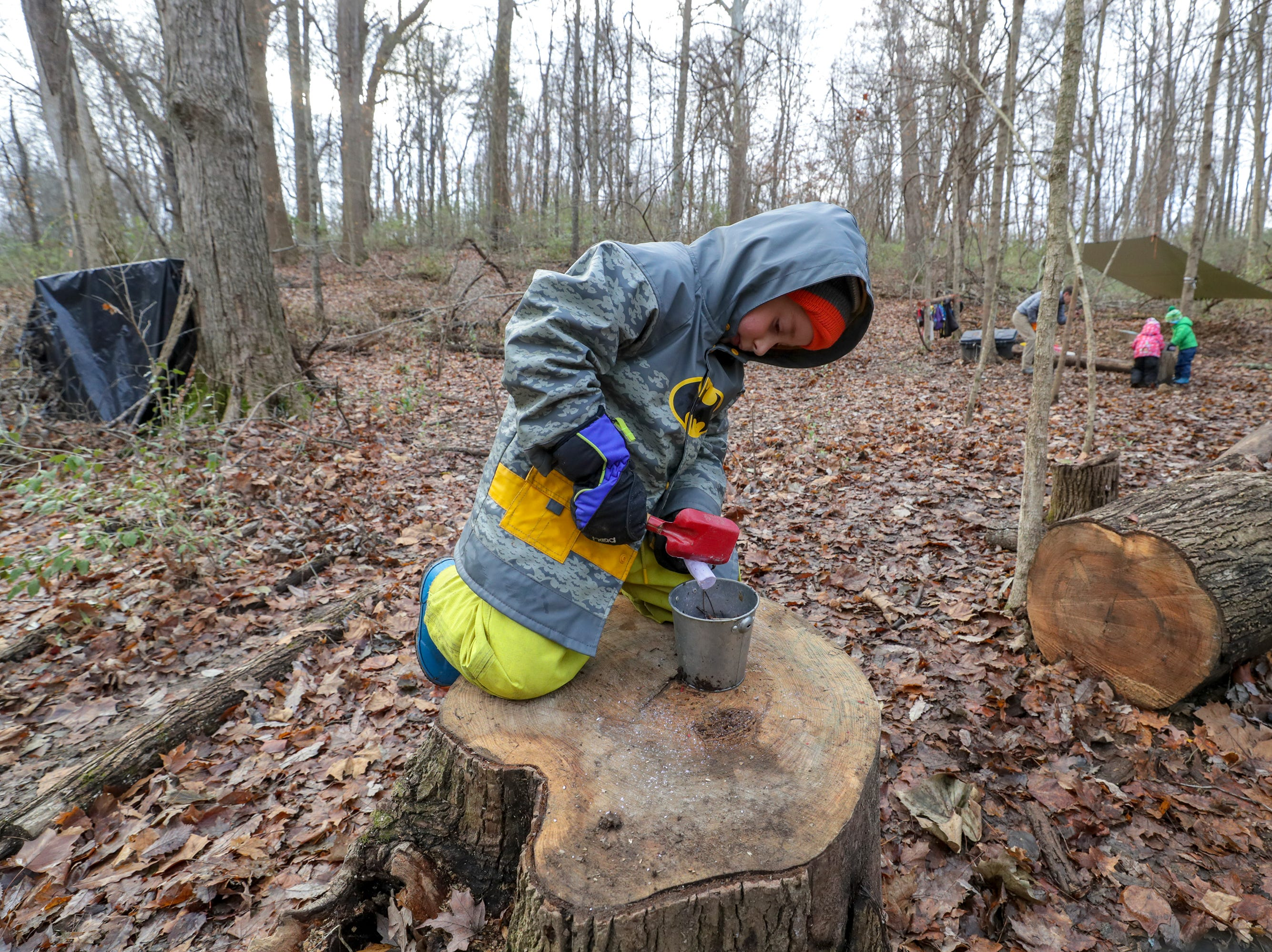 Quinn Mahoney works on a concoction consisting of leaves, twigs, stream water, mud and chalk at Thrive Forest School at Creasey Mahan Nature Preserve.November 19, 2018
