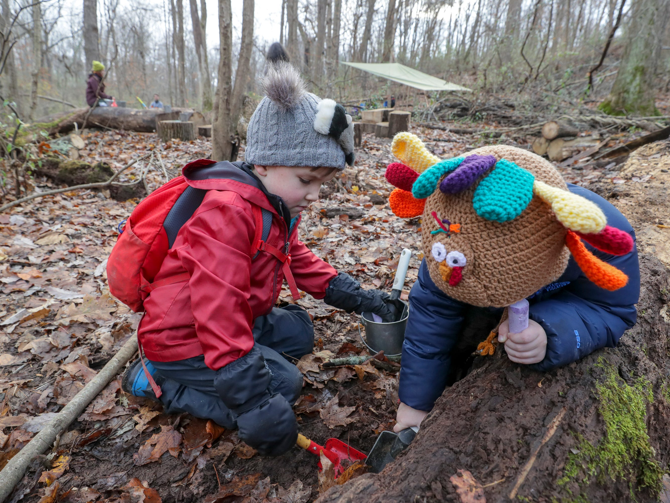 Will Clark and Lincoln Oakes check out what's under a fallen log as they play at Thrive Forest School at Creasey Mahan Nature Preserve.November 19 2018