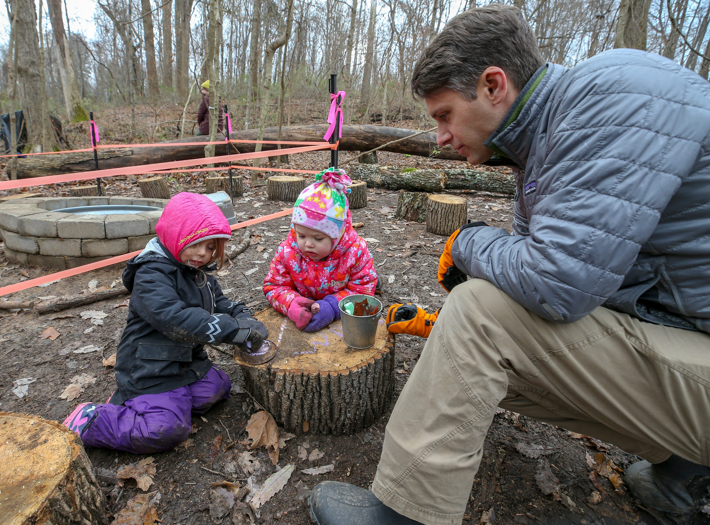 Ryan Devlin, Thrive Forest School founder, works with Piper Riddle and Hannah Rose O'Connell at Creasey Mahan Nature Preserve.November 19, 2018