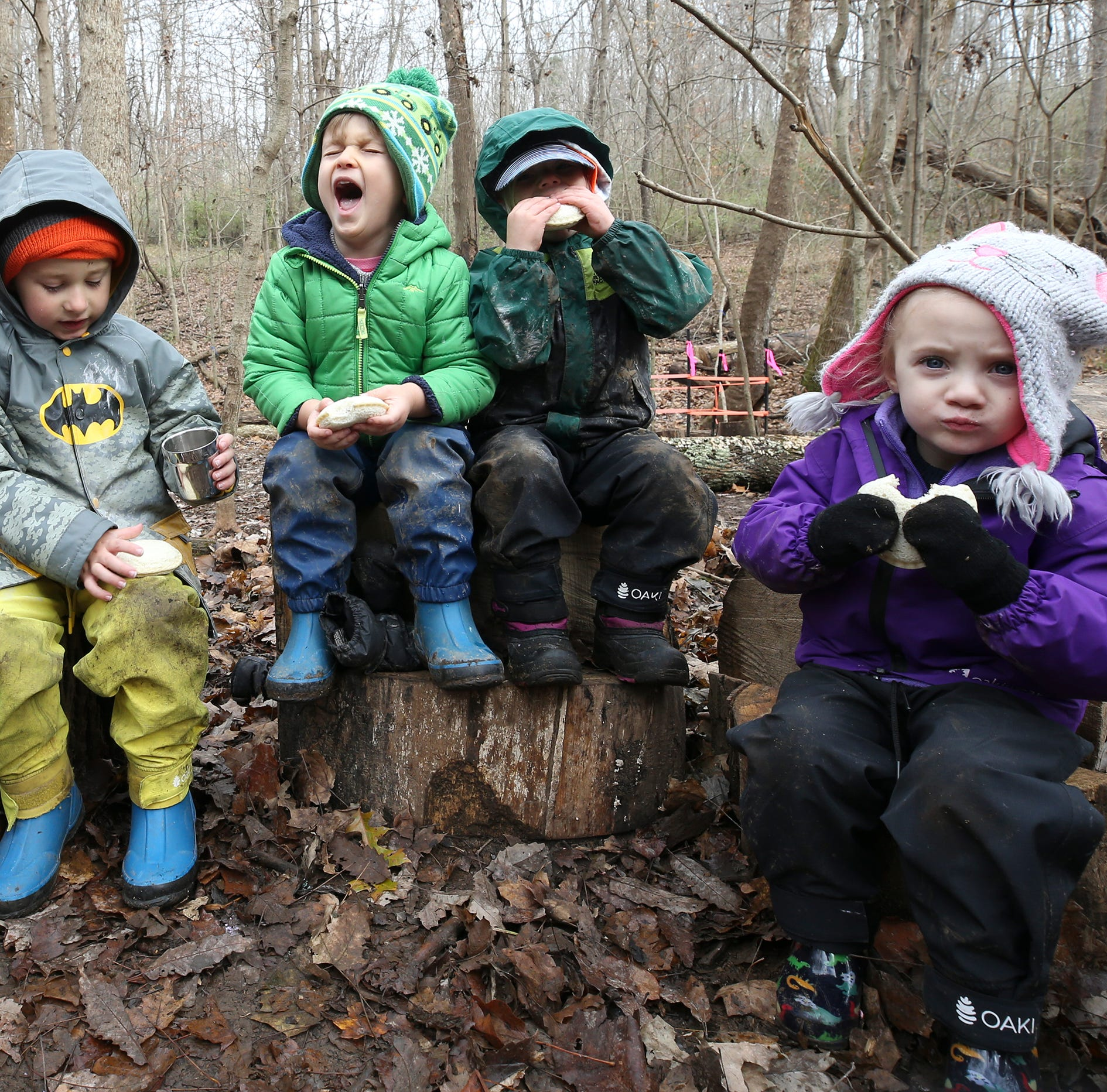 Thrive students Will Clark, Quinn Mahoney, Ferris Devlin, Palmer Harris and Julia Eskridge prepare for lunch in their outdoor classroom at Creasey Mahan Nature Preserve.