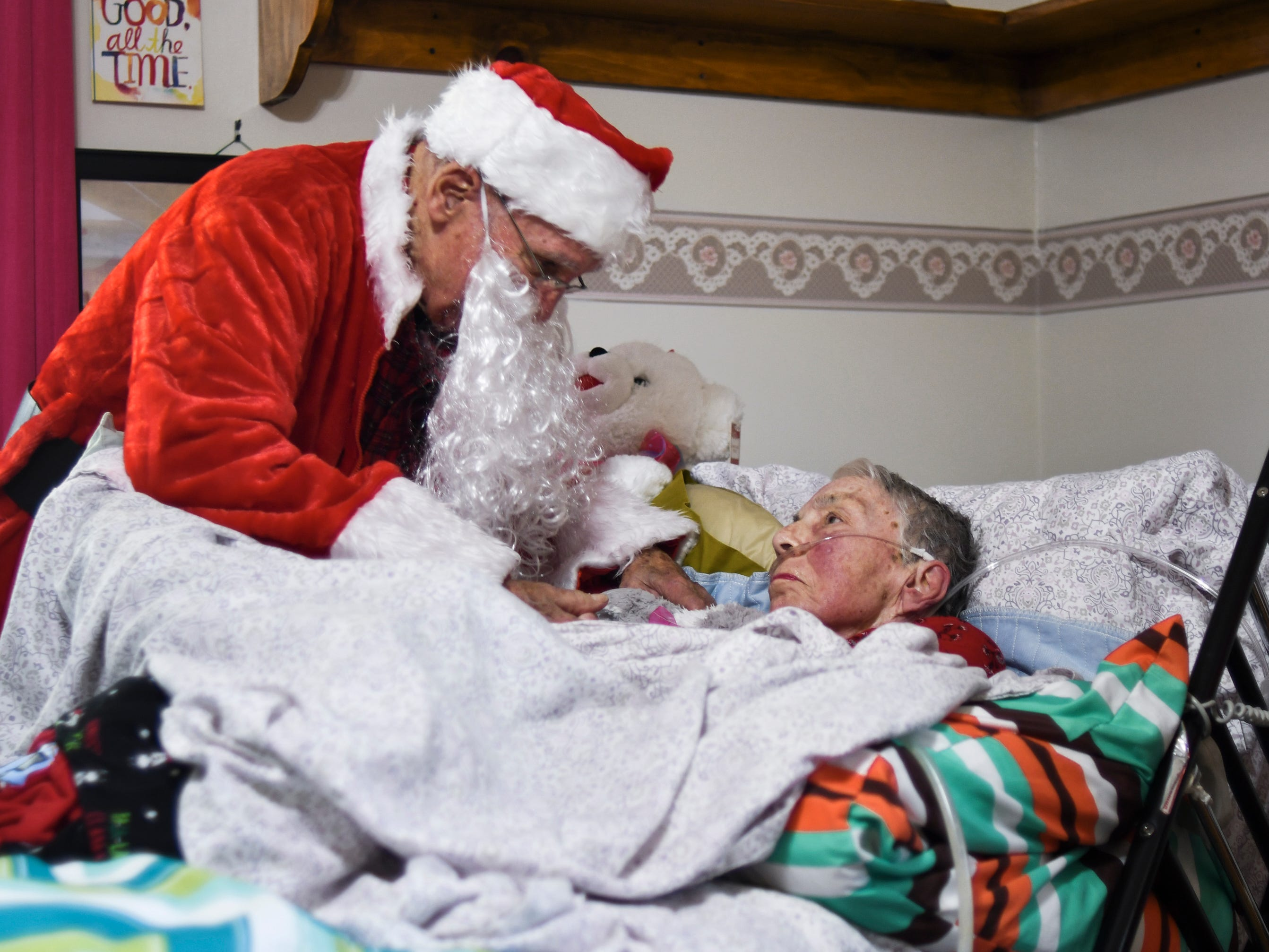 """I'm Santie Claus,"" he joked.  ""Don't tell anyone who I really am,"" Don West, 90, of Eaton Rapids whispered to his wife Jackie, Saturday, Dec. 8, 2018, during a Christmas party at Golden Days II Adult Foster Care in Charlotte, before singing  ""Santa Claus is Coming to Town"" at her bedside.  Jackie has been a nursing home since suffering a stroke in June of 2017."