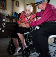 Don West, 90, middle, of Eaton Rapids, sings to his wife Jackie, Tuesday, Aug. 21, 2018, during their 64th anniversary party at Golden Days II Adult Foster Care nursing home in Charlotte.  Jackie, who died Jan. 14, had been at the home since her stroke in June of 2017.
