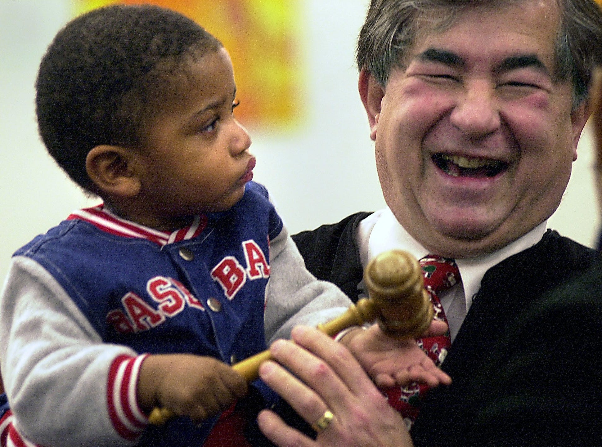 Judge George Economy laughs as he tries to get his gavel back Dec. 23, 2003, from Martel James, 18 months after Economy finalized Martel's adoption by his grandmother, Deloris (cq) James in Economy's courtroom.