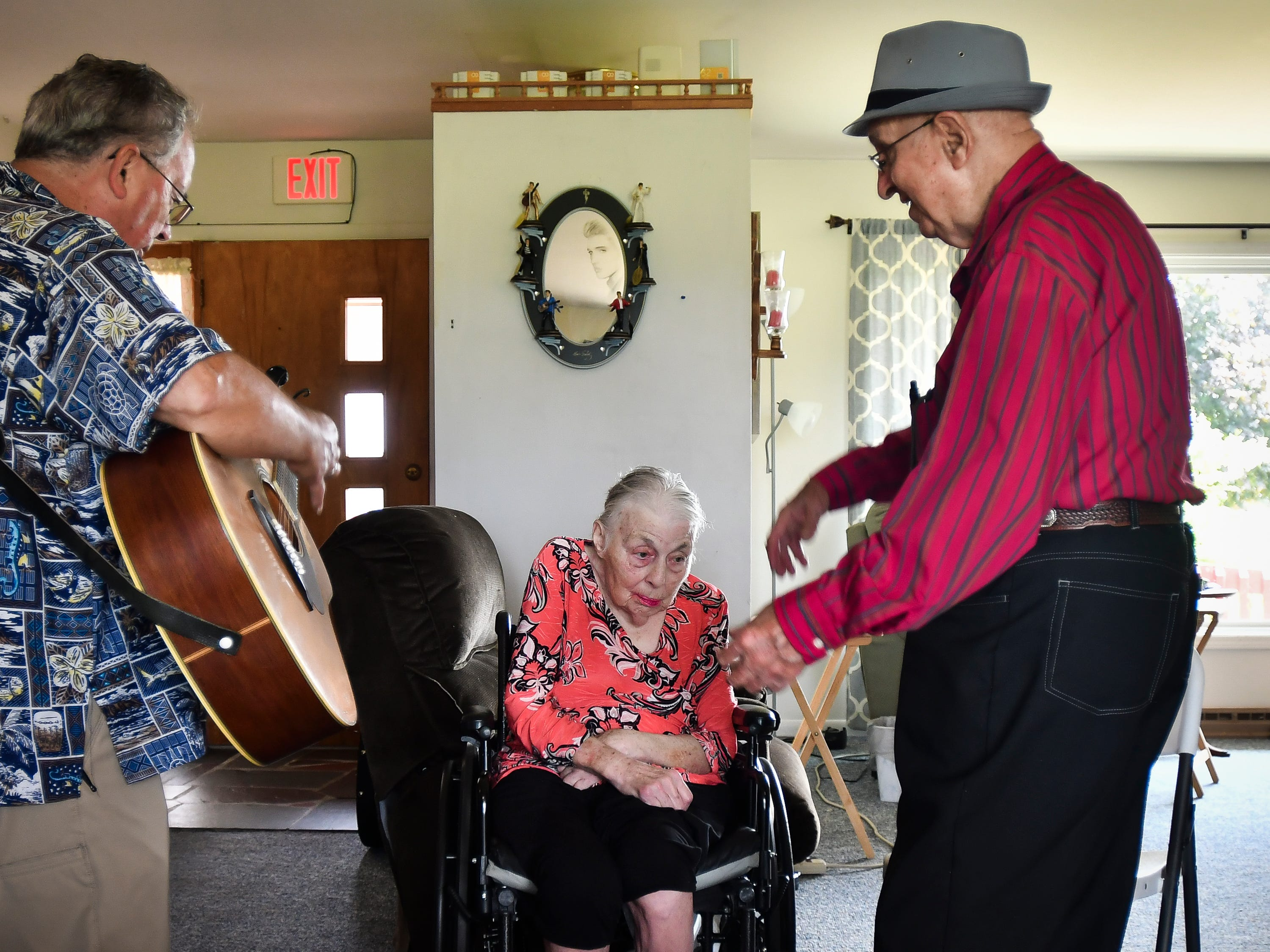 "Don West dances and sings for his wife Jackie, Tuesday, Aug. 21, 2018, during their 64th wedding anniversary party at Golden Days II Adult Foster Care nursing home in Charlotte. Jackie had a stroke in June of 2017 and has been in a nursing home since. ""She's not coming home, so I figured I'd take the party to her,"" West said. Also pictured is Dennis Michaels, left, a musician who's played several parties for Don and Jackie."
