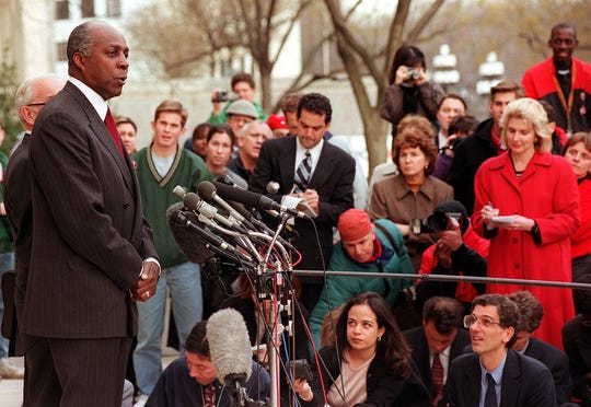WASHINGTON, D.C. - MARCH 5:  Vernon E. Jordan Jr. (left), close friend and unofficial advisor to President Bill Clinton, speaks to reporters March 5, 1998 outside the U.S. District Court House in Washington, D.C.  Jordan completed his second day of testimony to the grand jury investigating the relationship between Clinton and former White House intern Monica Lewinsky.