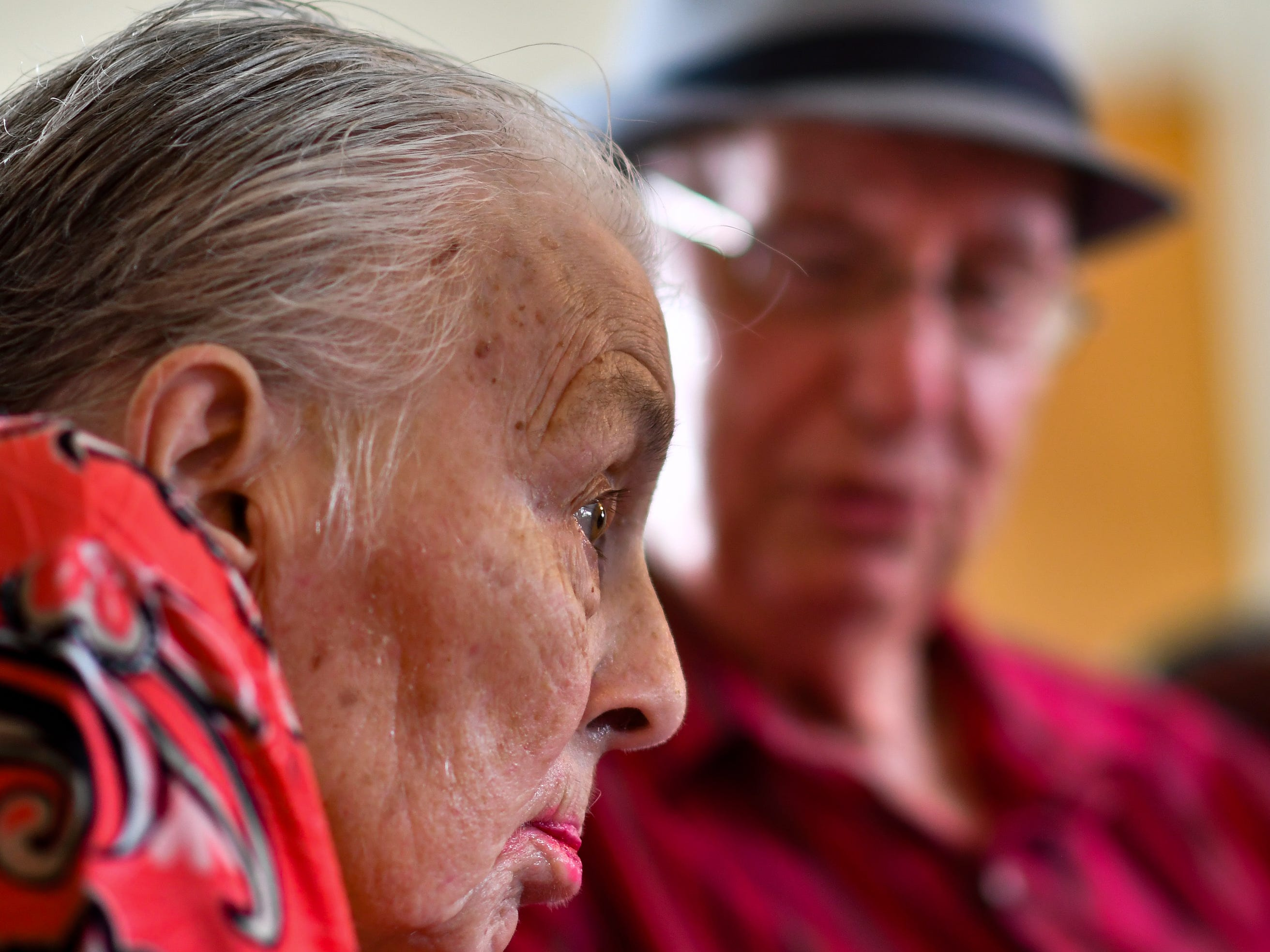 Jackie West, 86, of Eaton Rapids, listens as her husband Don, 90, sings to her, Tuesday, Aug. 21, 2018, at their anniversary party at the adult foster care home in Charlotte where she has lived since a stroke in June of 2017.