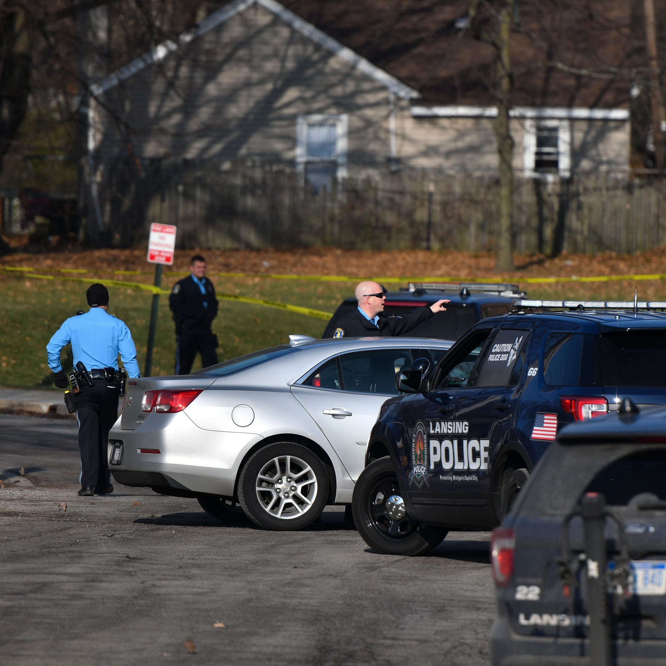 Police find man dead near two public housing complexes in south Lansing