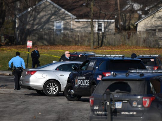 Members of the Lansing Police Department investigate the scene of a fatal shooting Wednesday afternoon, Dec. 12, 2018, near an apartment complex on the corner of South Washington and Southland avenues in Lansing.
