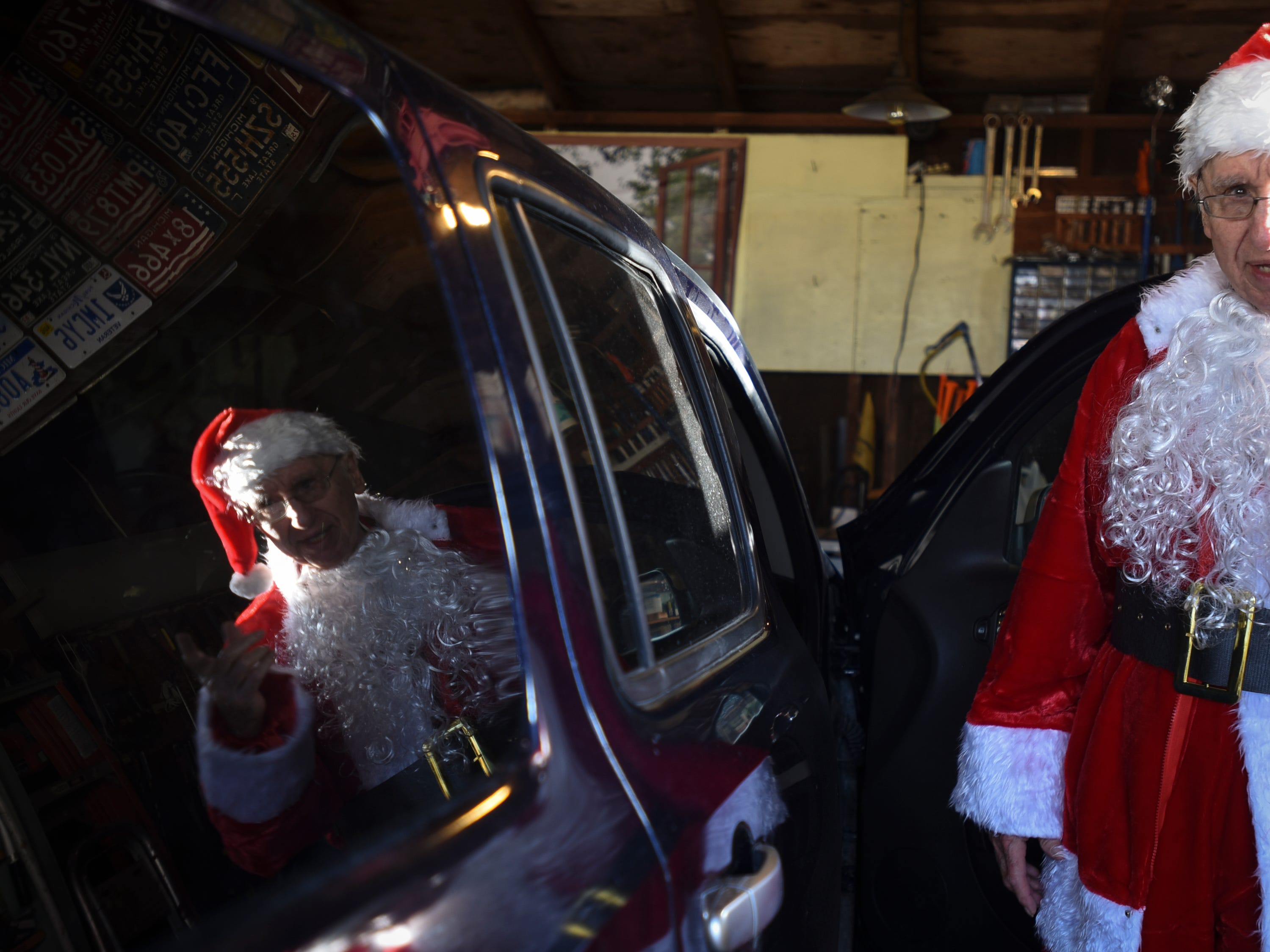 "Don West, 90, of Eaton Rapids, talks about the Christmas party he's headed to as he gets in his car, Saturday, Dec. 8, 2018, at Golden Days II Adult Foster Care in Charlotte, where his wife Jackie has been since March.  Don hired musician Dennis Michaels to play music, and has prepared gifts for every resident, staff member, and their children with tags that read ""from Jackie,"" his wife of 64 years."