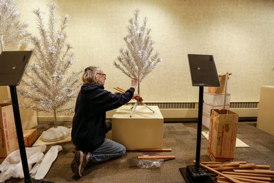 Francine Pfeffer, of Appleton, sets up Evergleams from her personal collection for a display at the Rahr-West Museum Tuesday, November 20, 2018, in Manitowoc, Wis. Joshua Clark/USA TODAY NETWORK-Wisconsin