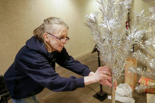 Evergleam collector Francine Pfeffer, of Appleton, sets up a silver Evergleam at the Rahr-West Museum for Evergleams on 8th Tuesday, November 20, 2018, in Manitowoc, Wis. Joshua Clark/USA TODAY NETWORK-Wisconsin