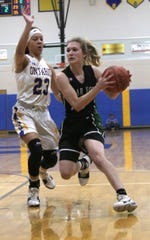 Clear Fork's Carson Crowner moves the ball past Ontario's Carleigh Pearson on Tuesday evening.