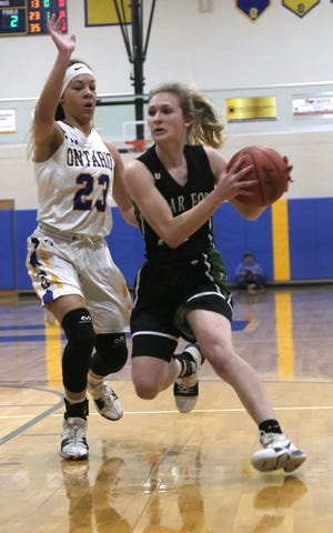 Clear Fork's Carson Crowner moves the ball past Ontario's Carleigh Pearson earlier in the season.