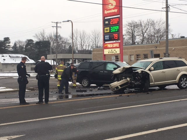 Mansfield police and firefighters assist at a two-vehicle injury crash at Park Avenue West and Brookwood Way on Wednesday.