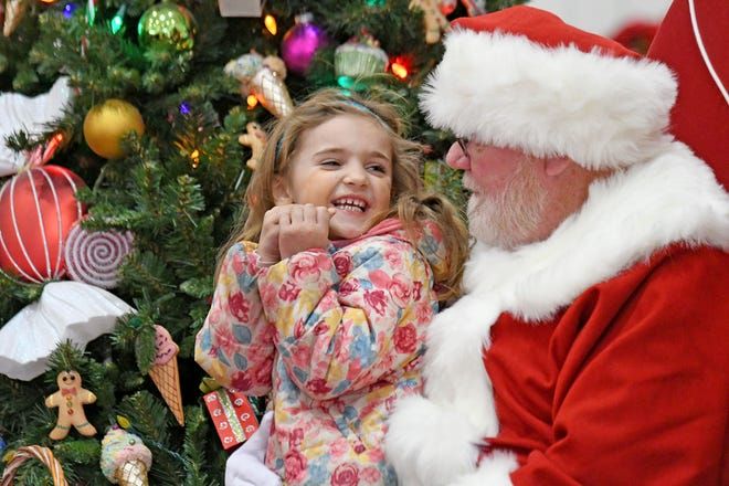 Sidney Fromm, 4, of Shelby, visits with Santa on Wednesday afternoon at the Richland Mall.