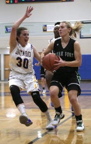 Clear Fork's Valerie Golden attempts a shot in front of Ontario's Asten Vavra earlier in the season.