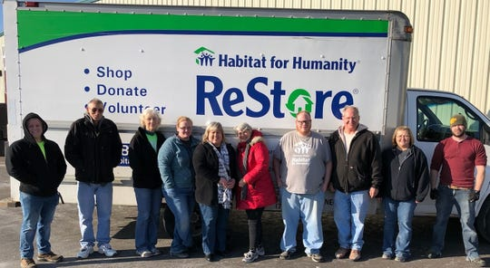 Habitat Team members pictured in front of the ReStore truck, soon to be replaced by a newer truck provided by a Marion Community Foundation grant: Connor Neff, Keith Miller, Judy Steed, Jolene Farrell, Christy Neff, Lynn Zucker, Cole Litzenberg, Steve Lawrence, Tera Simon, Ron Simon.