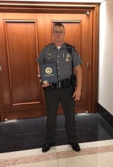 Trooper Craig Overly holding an award he received for a traffic stop initiated earlier this year that eventually caused the seizure of large quantities of drugs.