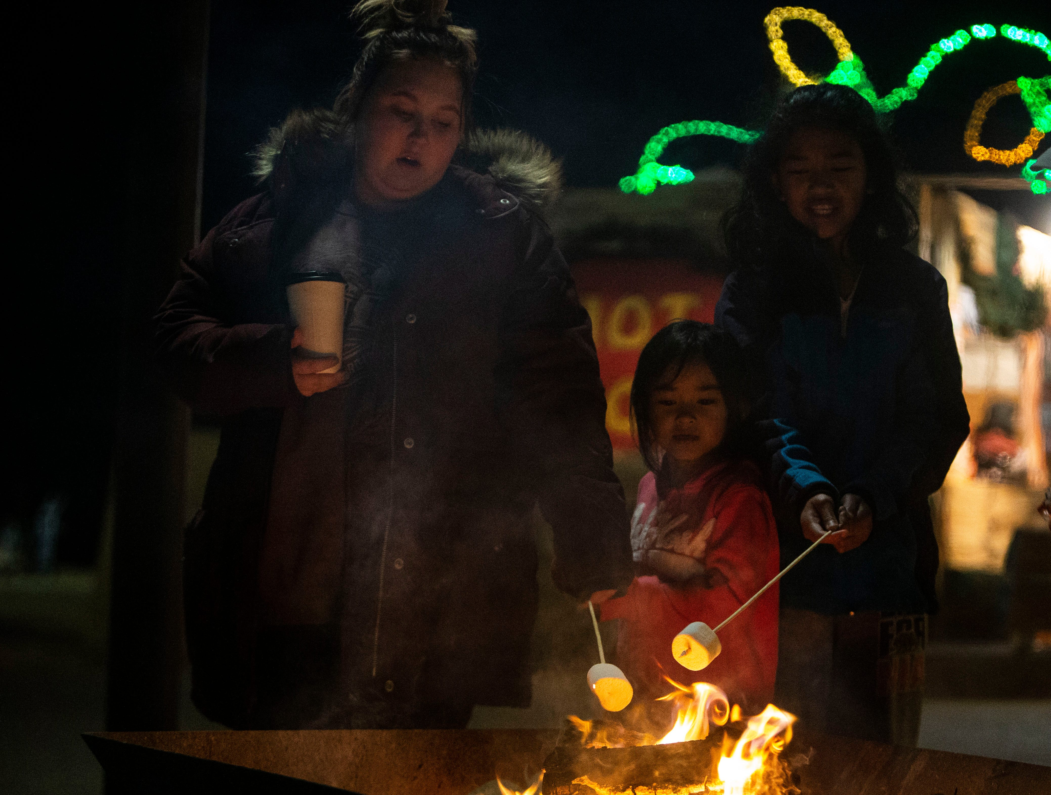 Kaitlyn Waldo, Angelina Liv and Arlenna Siv roast marshmallows at Starry Nights, annual drive-through light display at Shelby Farms, Tuesday, Dec. 11, 2018.