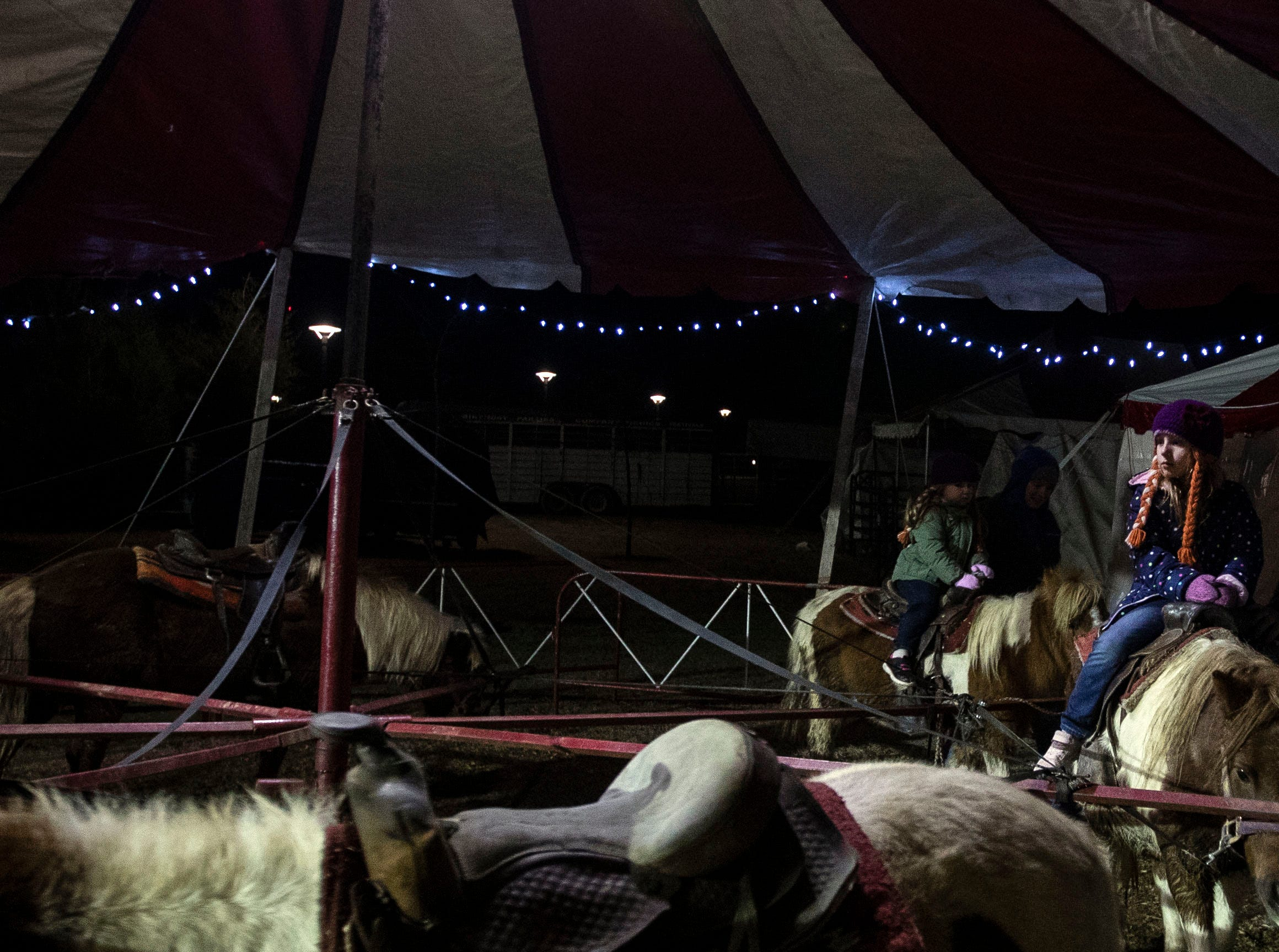 Carlee Blue Jenkins rides a pony at the Starry Nights, annual drive-through light display at Shelby Farms, features walking trails of lights and a drive-through display.