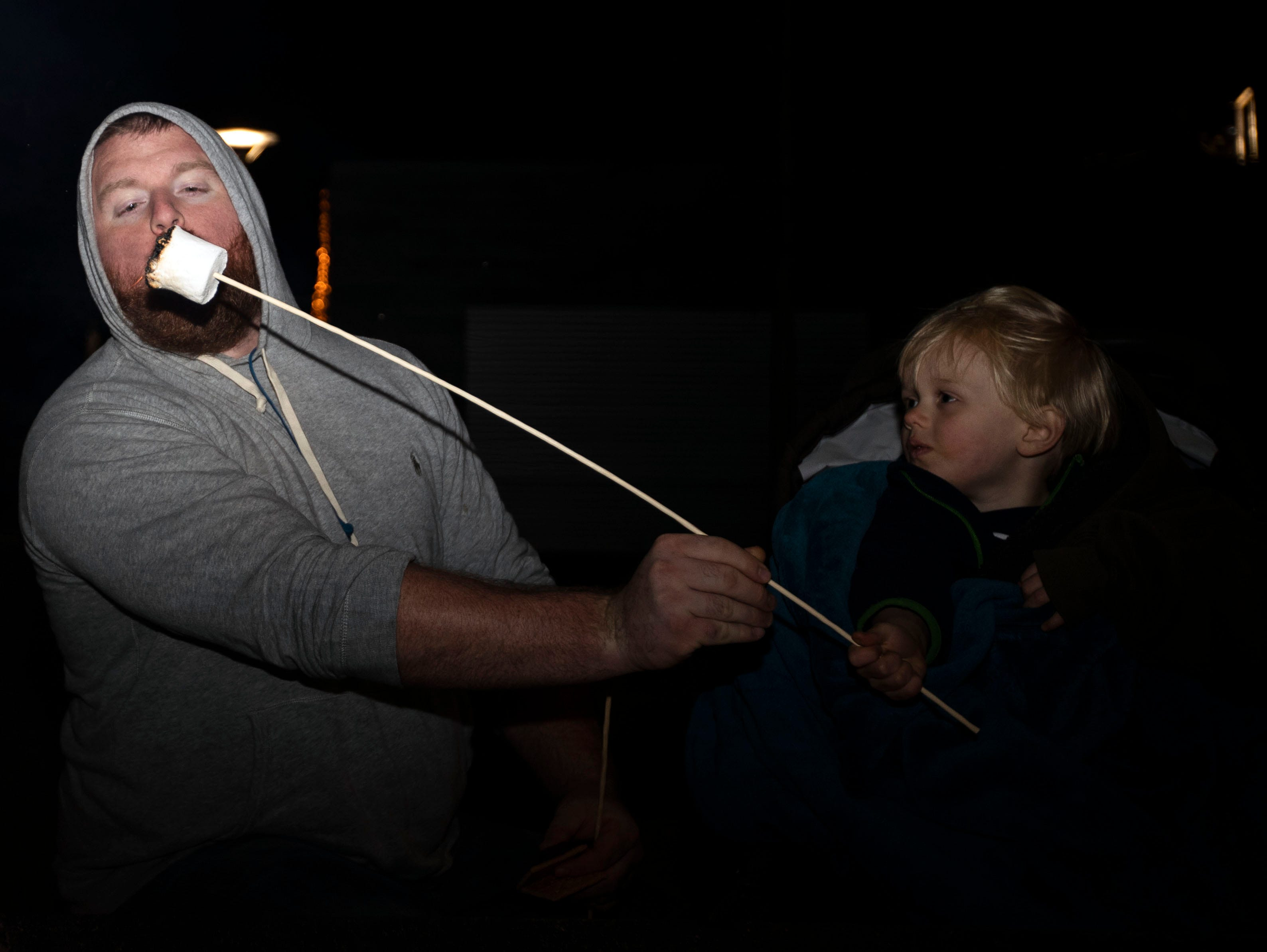 Cam and Tyler Pounders share a marshmallow at the Starry Nights, annual drive-through light display at Shelby Farms, features walking trails of lights and a drive-through display.