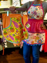 Muddy's Bake Shop carries brightly colored, one-of-a-kind aprons handmade by Carolyn Dodson-King of Carolyn Olivia's Aprons.