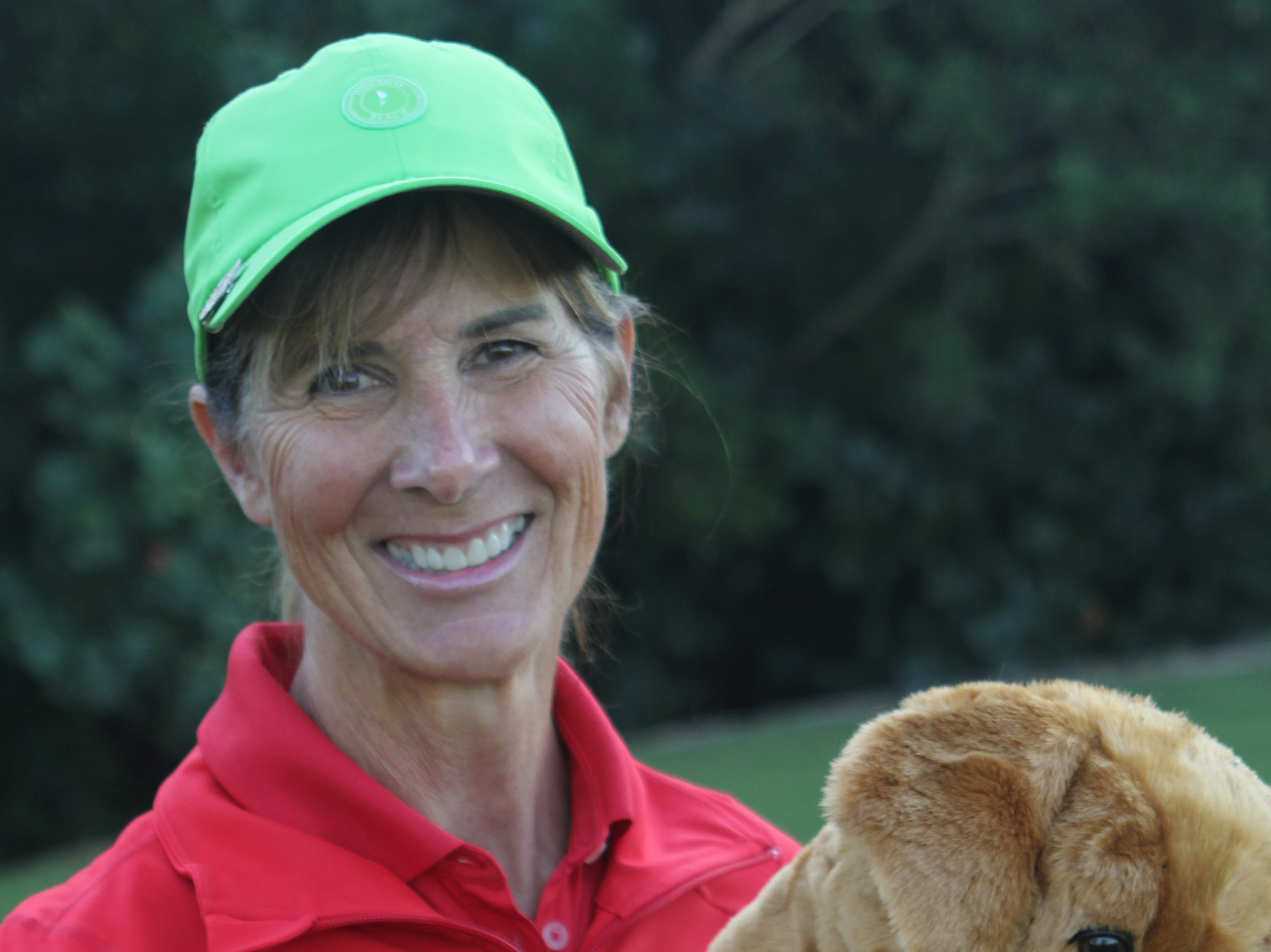 Gina Day's driver cover has a story. She trains golden retrievers to be service dogs for combat wounded veterans.