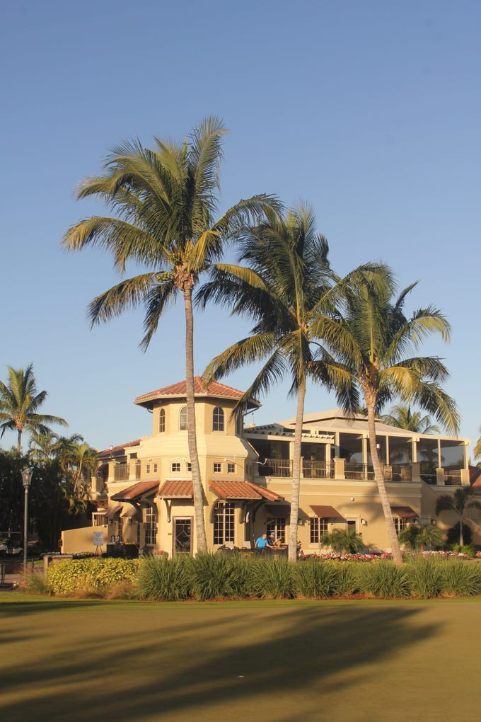 Hammock Bay's clubhouse reflects the early morning light.