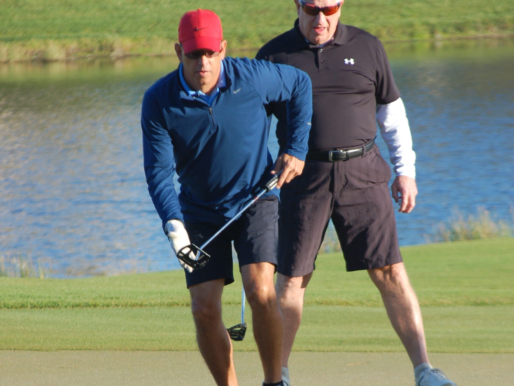 A player moves in towarda putt (which he sank) during the annual Greater Marco Family YMCA tournament over the weekend.