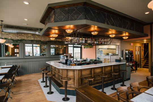 The original pressed-tin tiles from the ceiling decorate the soffit over the bar at Uncle Wolfie's Breakfast Tavern, 234 E. Vine St. The restaurant was designed to look like it had always been in the 1902 building, said 360 Degrees project manager Ryan Foat.