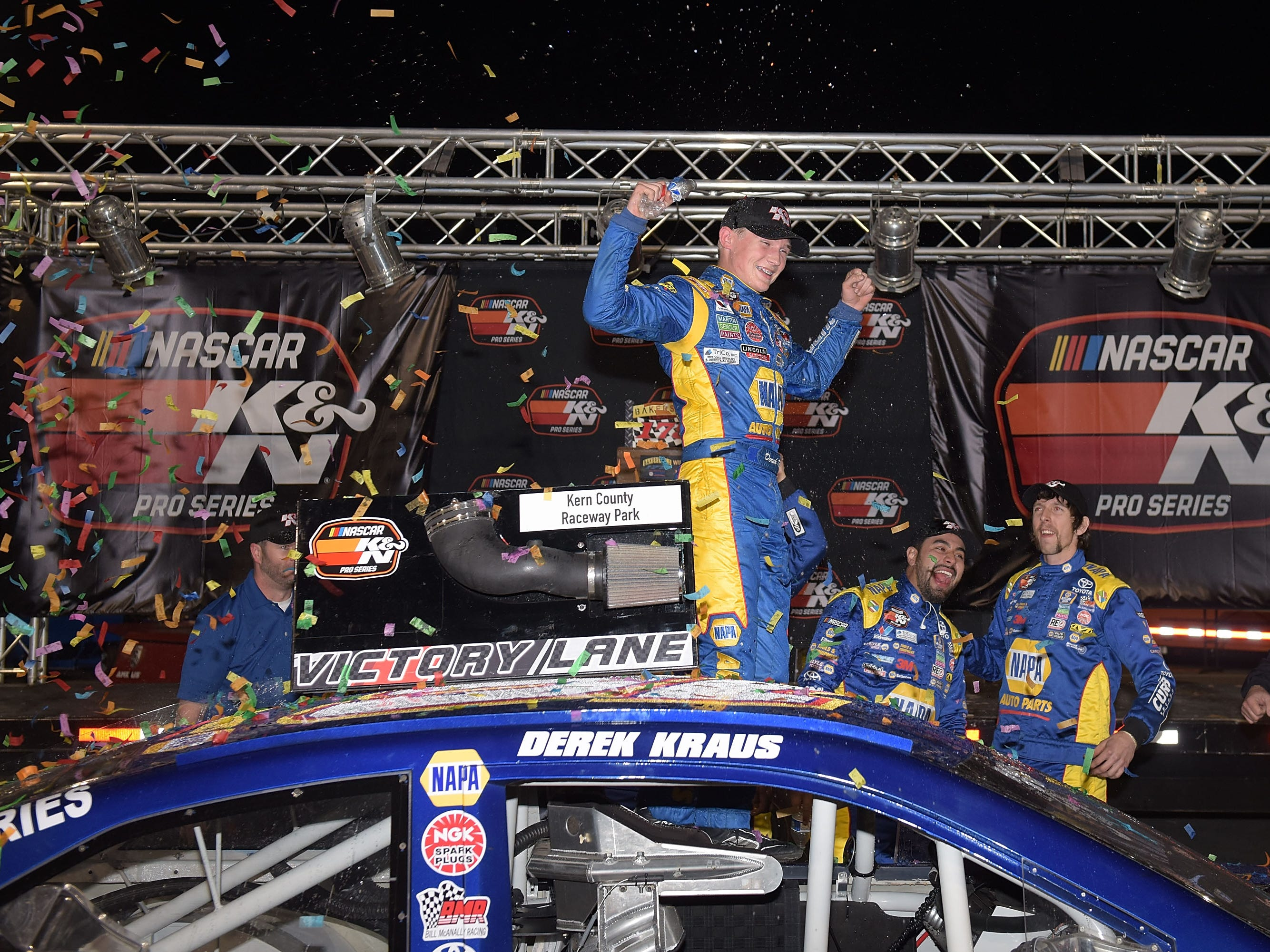 BAKERSFIELD, CA - MARCH 15:  Derek Kraus, driver of the #16 NAPA Auto Parts / Curb Records Toyota, celebrates in victory lane after winning the NASCAR K&N Pro Series West Bakersfield 175 presented by NAPA Auto Parts at Kern County Raceway Park on March 15, 2018 in Bakersfield, California.  (Photo by Jonathan Moore/Getty Images for NASCAR)
