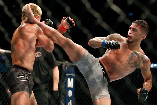 Milwaukee's Sergio Pettis (right) is shown kicking Joseph Benavidez during thier UFC matchup in June.