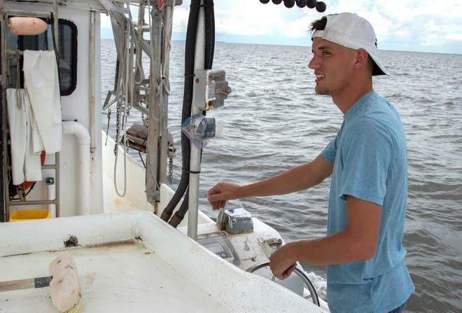 "Tommy Olander Jr. on Aug. 9 drives his family's shrimping boat in Vermillion Bay off the Louisiana coast near Jeanerette. Vermillion Bay, inland of the oxygen-deprived ""dead zone,"" was expected soon to be full of shrimp boats for the opening of the fall season as trawlers compete in the same inland waters for a shrinking pool of shrimp."