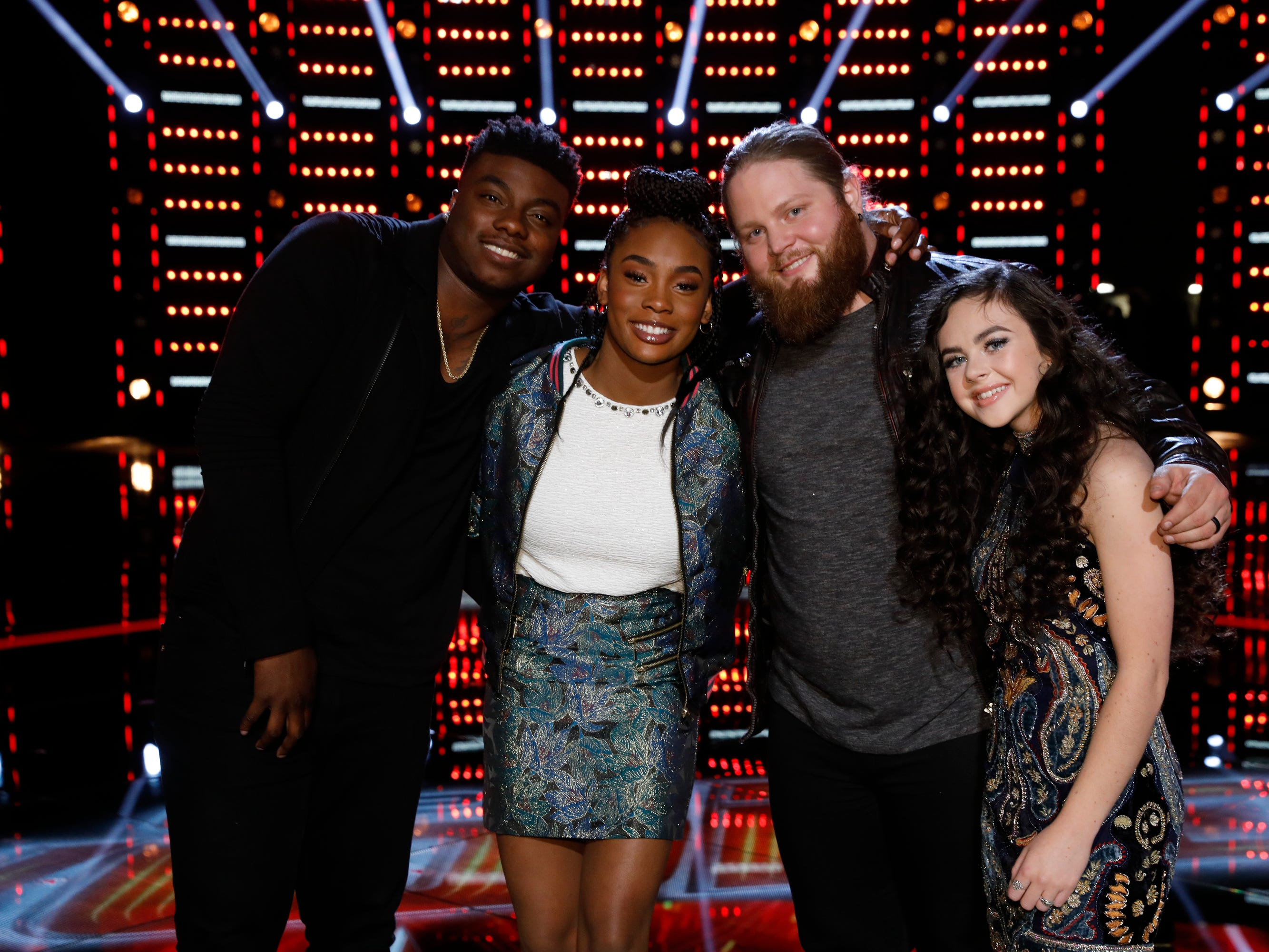 "Kroeze poses on the set of ""The Voice"" with his fellow finalists Kirk Jay, Kennedy Holmes and Chevel Shepherd after the Dec. 11 episode."