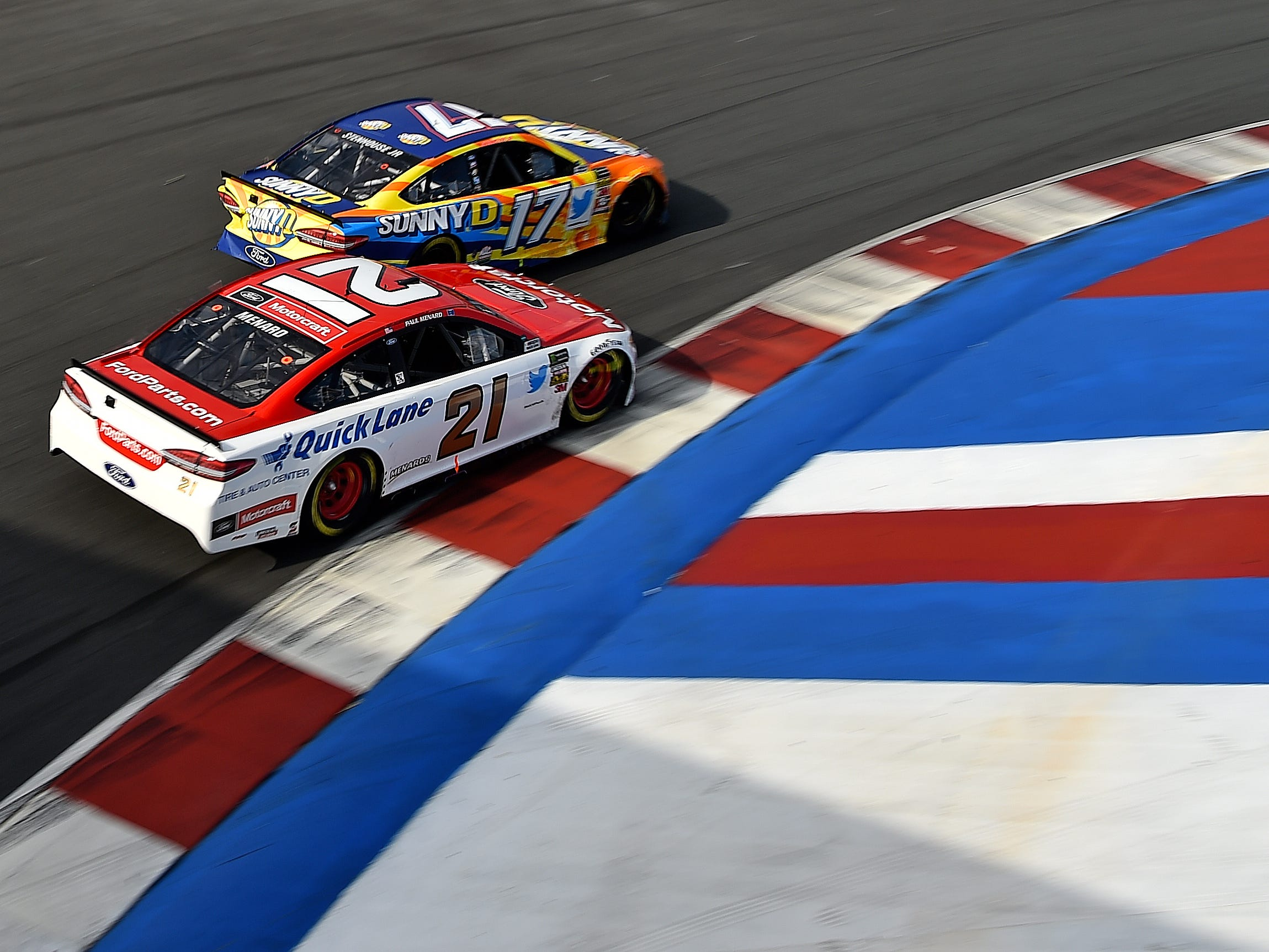 Sep 30, 2018; Concord, NC, USA; NASCAR Cup Series driver Ricky Stenhouse Jr. (17) leads Paul Menard (21) during the Bank of America Roval 400 at Charlotte Motor Speedway Road Course. Mandatory Credit: Jasen Vinlove-USA TODAY Sports