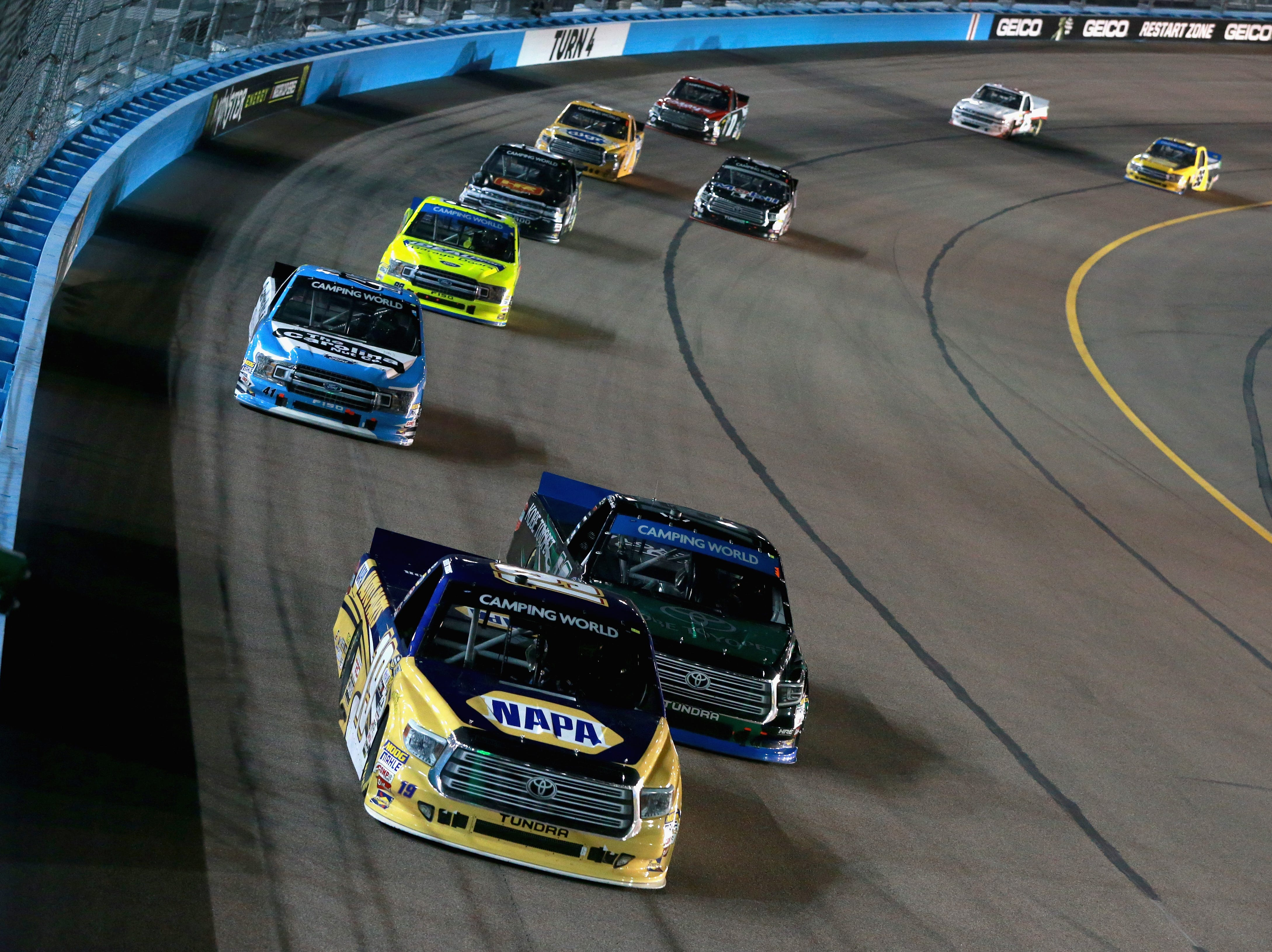PHOENIX, AZ - NOVEMBER 09:  Derek Kraus, driver of the #19 NAPA Auto Parts Toyota, leads a pack of trucks during the NASCAR Camping World Truck Series Lucas Oil 150 at ISM Raceway on November 9, 2018 in Phoenix, Arizona.  (Photo by Sean Gardner/Getty Images)